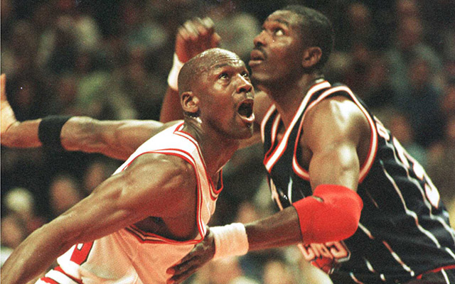 3 JAN 1996: MICHAEL JORDAN OF THE CHICAGO BULLS, LEFT, AND HAKEEM OLAJUWON OF THE HOUSTON ROCKETS BATTLE FOR POSITION UNDER THE BASKET DURING FIRST QUARTER ACTION WEDNESDAY NIGHT AT THE UNITED CENTER IN CHICAGO, ILLINOIS. THE BULLS WENT ON TO BEAT THE RO